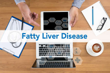 fatty liver: Fatty  Liver  Disease Doctor touch digital tablet, desktop with medical equipment on background, top view, coffee