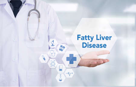 fatty liver: Fatty  Liver  Disease Medicine doctor hand working  Professional doctor use computer and medical equipment all around, desktop top view