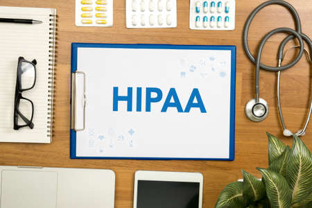 HIPAA Professional doctor use computer and medical equipment all around, desktop top view Stock Photo