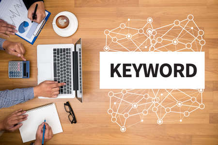 meta data: KEYWORDS Business team hands at work with financial reports and a laptop