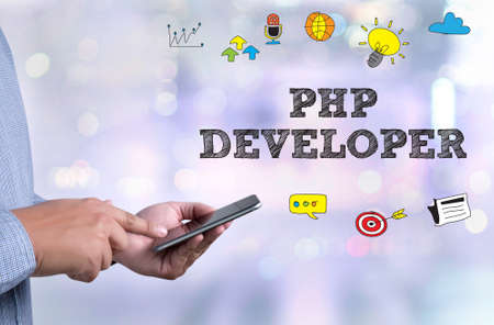PHP DEVELOPER  person holding a smartphone on blurred cityscape background
