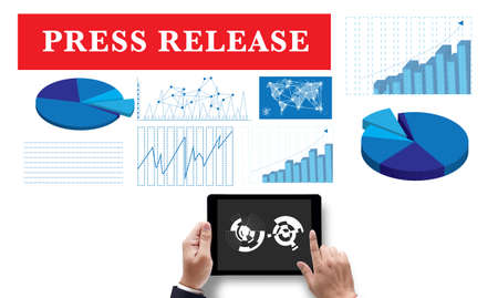 Press Release, on the tablet pc screen held by businessman hands - online, top view