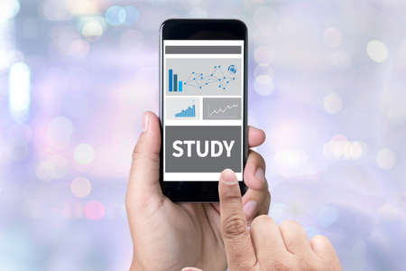 study table: STUDY Student Studying Hard and Students Studying Learning Education person holding a smartphone on blurred cityscape background