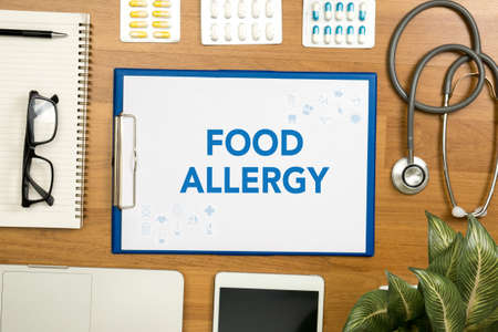 food allergy: FOOD ALLERGY Professional doctor use computer and medical equipment all around, desktop top view