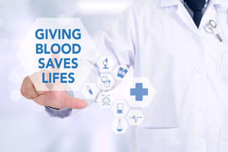 GIVING BLOOD SAVES LIFES Medicine doctor working with computer interface as medical