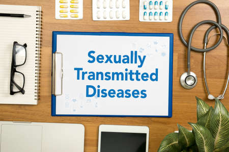 Sexually Transmitted Diseases Professional doctor use computer and medical equipment all around, desktop top view