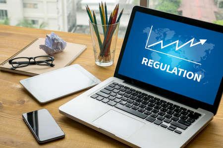 regulation: REGULATION Laptop on table. Warm tone
