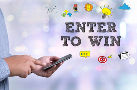 contestant: ENTER TO WIN person holding a smartphone on blurred cityscape background