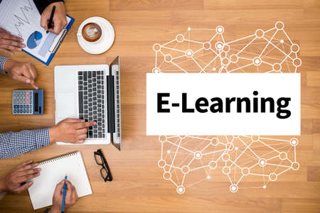 knowledge business: LEARN Learning Education Knowledge and Knowledge Training E-Learning Skills Start Up Business team hands at work with financial reports and a laptop
