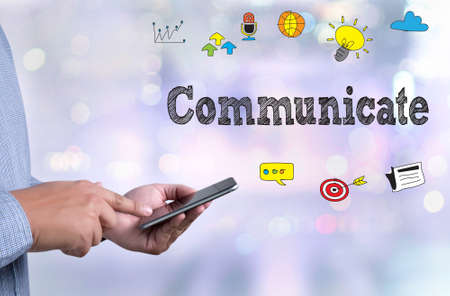 communicate: Broadcast Communicate Music Icon Connection use Communicate person holding a smartphone on blurred cityscape background