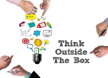 broad: Think Outside The Box  businessman work on white broad, top view Stock Photo