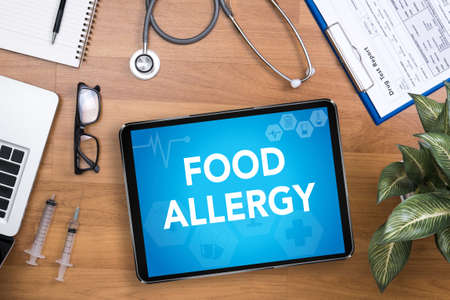 use computer: FOOD ALLERGY Professional doctor use computer and medical equipment all around, desktop top view