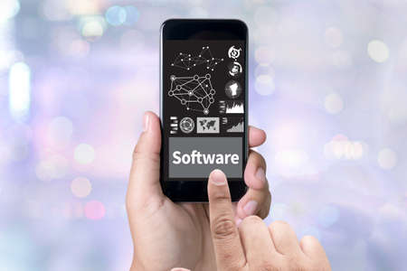 programs: Software Data Digital Programs System Technology computer person holding a smartphone on blurred cityscape background