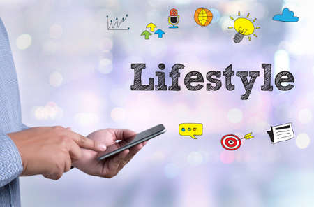 Lifestyle  Way of Life Habits Situation Culture Lifestyle me person holding a smartphone on blurred cityscape background