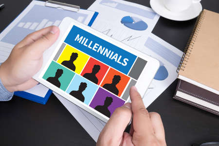 doing business: MILLENNIALS  Modern people doing business, graphs and charts and touch-pad Stock Photo
