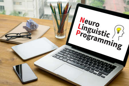 NLP   Neuro Linguistic Programming Laptop on table. Warm tone Stock Photo