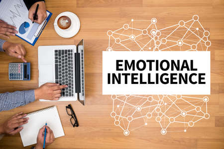 decreased: EMOTIONAL INTELLIGENCE Business team hands at work with financial reports and a laptop