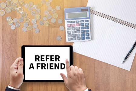 refer: REFER A FRIEND A finance Money, calculator notes, calculator top view  work Stock Photo
