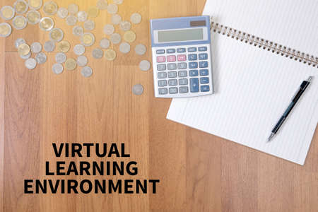 assessment system: VIRTUAL LEARNING ENVIRONMENT A finance Money, calculator notes, calculator top view  work