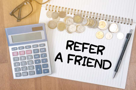refer: REFER A FRIEND A finance Money, calculator notes, calculator top view with work