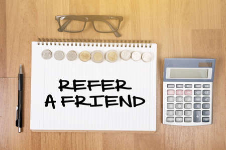 refer: REFER A FRIEND Top view of office desktop , laptop computer work