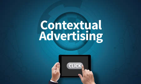 contextual: Contextual Advertising, on the tablet pc screen held by businessman hands - online, top view