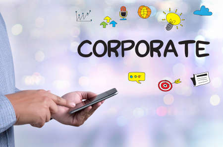 computation: CORPORATE Process Business Strategy Management  Teamwork and CORPORATE person holding a smartphone on blurred cityscape background