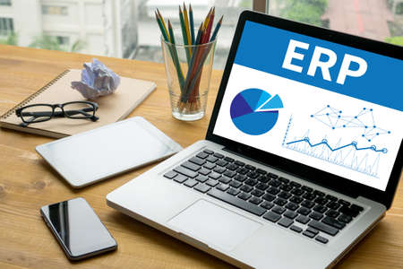 ERP  Laptop on table. Warm tone Standard-Bild