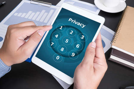 doing business: Privacy  Access Identification Password Passcode  and Privacy Modern people doing business, graphs and charts being demonstrated on the screen of a touch-pad,blank screen copy space Stock Photo