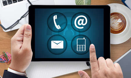 connect people: CONTACT US (Customer Support Hotline people CONNECT ), on the tablet pc screen held by businessman hands - online, top view
