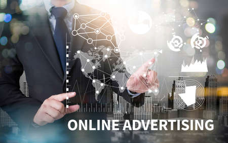 interstitial: ONLINE ADVERTISING and businessman working with modern technology Stock Photo