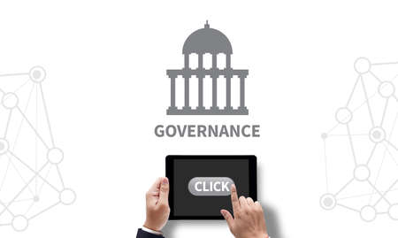 participatory: GOVERNANCE and Government building, Authority Government , on the tablet pc screen held by businessman hands - online, top view Stock Photo