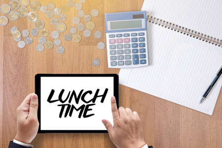 breakout: LUNCH TIME time for lunch words ,BUSINESSMAN WORKING AND LUNCH TIME Stock Photo