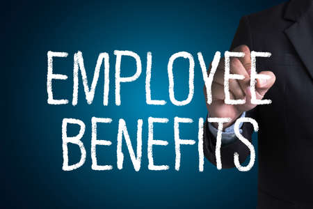 additional compensation: EMPLOYEE BENEFITS Man working on tablet TECHNOLOGY COMMUNICATION