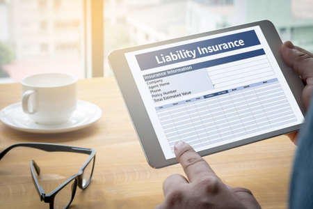 liability insurance: Form Document  Liability Insurance Money RIsk  Computing Computer  Laptop with screen on table Silhouette and filter sun Stock Photo
