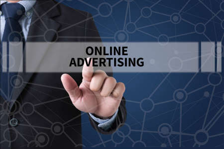 interstitial: ONLINE ADVERTISING Businessman hands touching on virtual screen and blurred city background