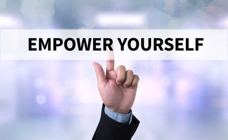 use computer: EMPOWER YOURSELF Businessman working at office desk and using a digital touch screen tablet and use computer Stock Photo