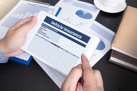 doing business: Form Document Vehicle Insurance Claim  Modern people doing business, graphs and charts and touch-pad