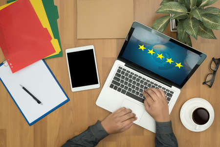 hotel reviews: Businessman holding five star rating,Review, increase rating or ranking, evaluation and classification concept Stock Photo