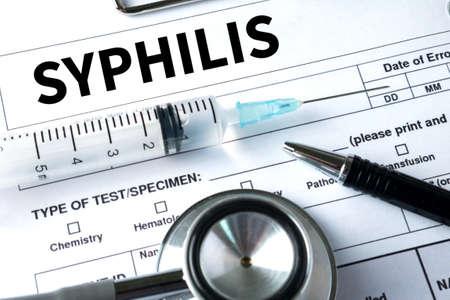 syphilis: SYPHILIS blood for Syphilis test , Syphilis - Printed Diagnosis  , Syphilitic ulcers ulcus durum , Syphilis positive , Stop Syphilis Stock Photo