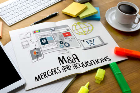 mergers: M&A (MERGERS AND ACQUISITIONS) , Mergers & Acquisitions  , Businessman working at office M&A