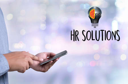 HR SOLUTIONS , choosing the perfect candidate to work , searching for professional  HR SOLUTIONS , HR SOLUTIONS Business team hands at work with financial reports