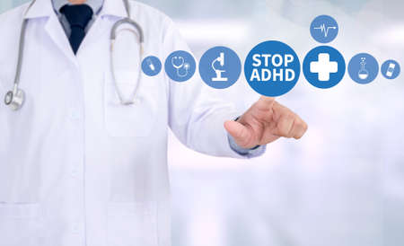STOP ADHD CONCEPT Medicine doctor hand working Professional doctor use computer and medical Stock Photo