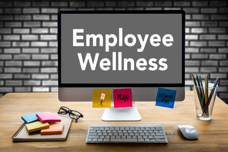 Employee Wellness program and Managing Health and program Business team hands at work Stock Photo