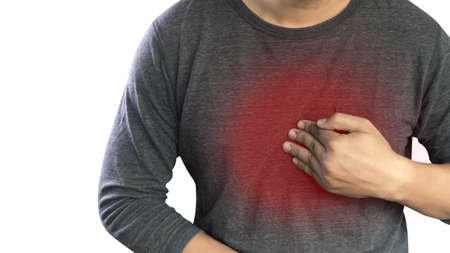 MAN with symptomatic acid reflux , suffering from acid reflux at park Stock Photo - 70033824