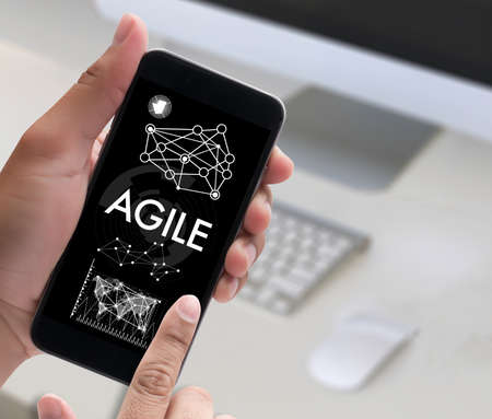 agile: Agile Agility Nimble Quick Fast Concept businessman working use smartphone on blurred abstract background