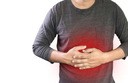 MAN with symptomatic acid reflux , suffering from acid reflux at park Stok Fotoğraf - 70906186