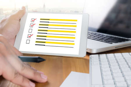 appraise: businessman  SURVEY and  Results Analysis Discovery Concept Stock Photo