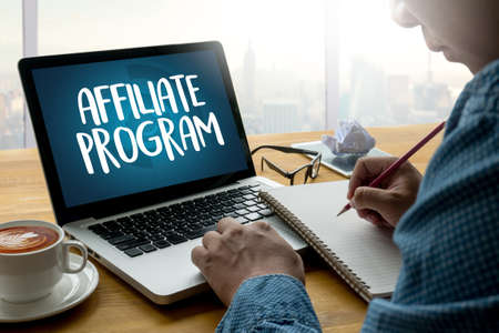 AFFILIATE PROGRAM Thoughtful male person looking to the digital tablet screen, laptop screen,Silhouette and filter sun