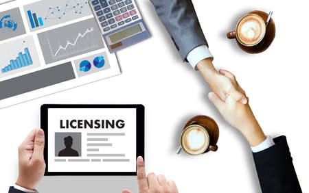 Patent License agreement LICENSING   business man hand working on laptop computer Stock Photo